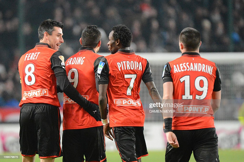 Rennes' French forward Mevlut Erding (2neL) is congratulated by teammates after scoring a goal during the French League Cup semifinal football match Rennes against Montpellier on January 16, 2013 at the route de Lorient stadium in Rennes, western France.