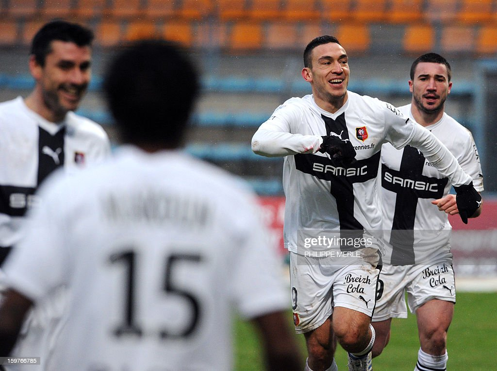 Rennes' French forward Mevlut Erding (2nd R) is congratulated by teammates after scoring a goal during the French L1 football match between Bastia and Rennes, on January 20, 2013, at the Jean Laville stadium in Gueugnon.
