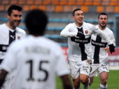 Rennes' French forward Mevlut Erding is congratulated by teammates after scoring a goal during the French L1 football match between Bastia and Rennes...