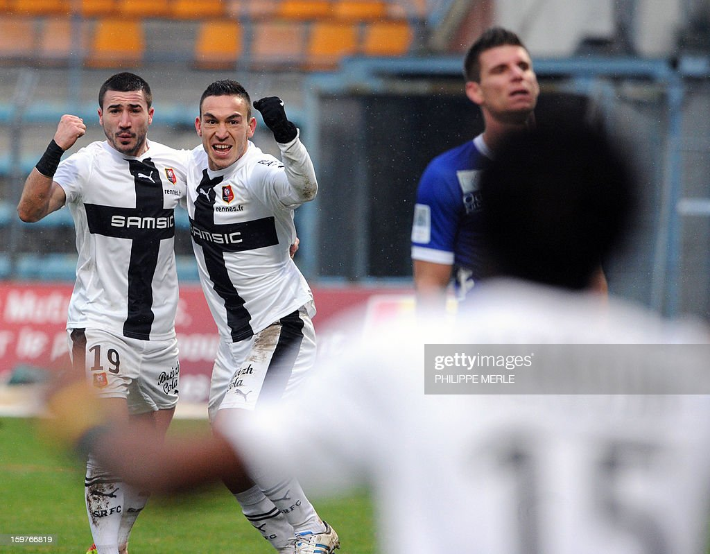 Rennes' French forward Mevlut Erding (2nd L) is congratulated by teammates after scoring a goal during the French L1 football match between Bastia and Rennes, on January 20, 2013, at the Jean Laville stadium in Gueugnon. AFP PHOTO / PHILIPPE MERLE