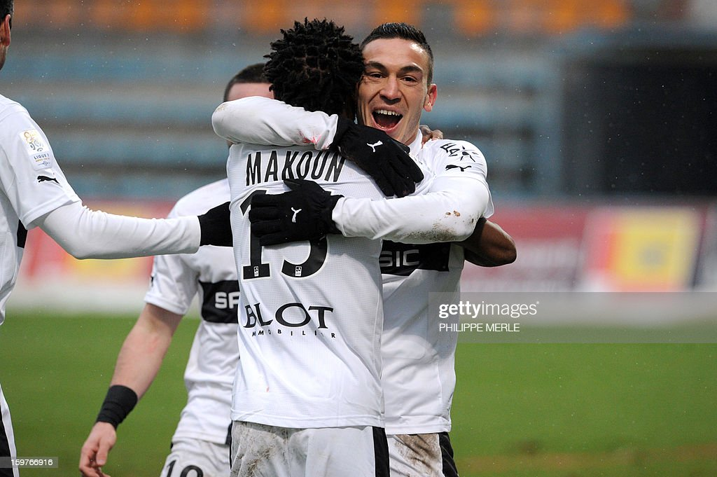 Rennes' French forward Mevlut Erding (R) is congratulated by teammates after scoring a goal during the French L1 football match between Bastia and Rennes, on January 20, 2013, at the Jean Laville stadium in Gueugnon.