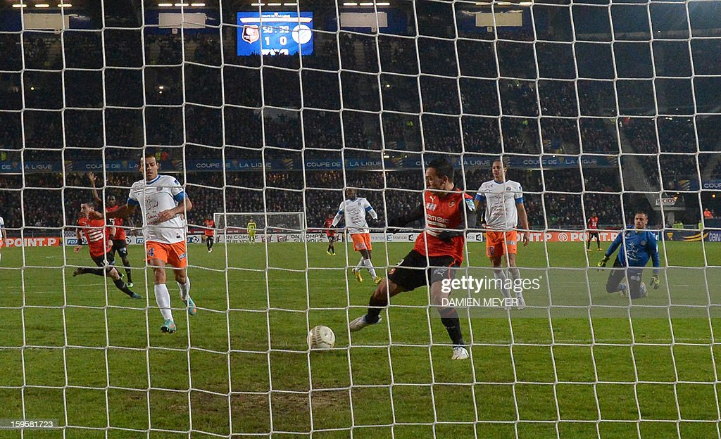 Rennes' French forward Mevlut Erding scores a goal during a French League Cup semifinal football match between Rennes and Montpellier on January 16, 2013 at the route de Lorient stadium in Rennes, western France.