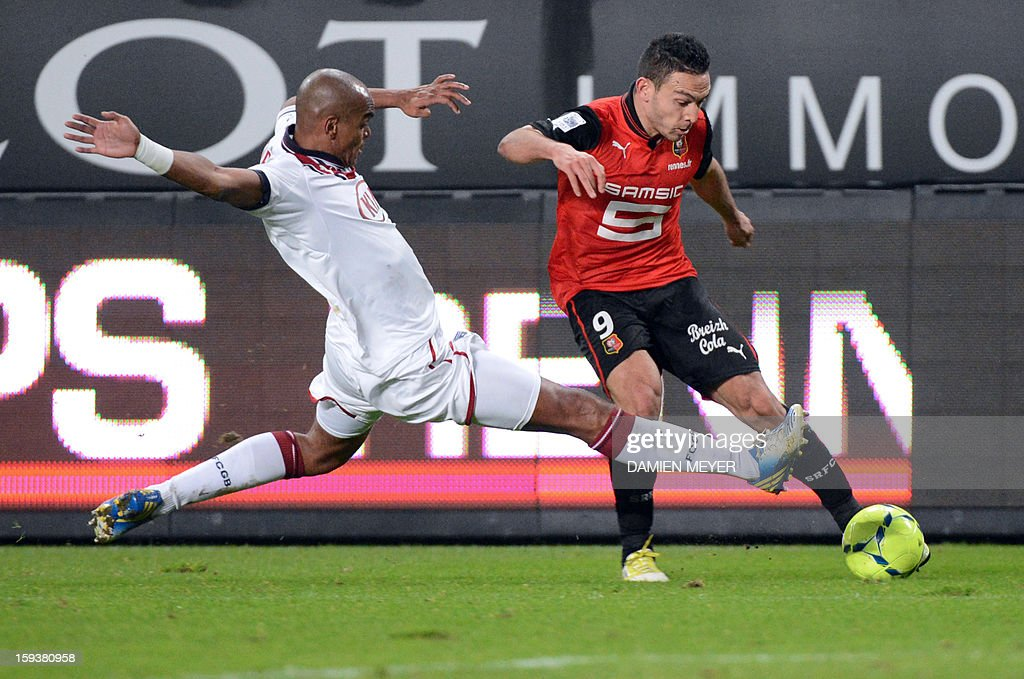 Rennes' French forward Mevlut Erding (R) vies for the ball with Bordeaux's Brazilian defender Carlos Henrique during the French L1 football match between Rennes and Bordeaux on January 12, 2013, at the Route de Lorient stadium in Rennes, western France.
