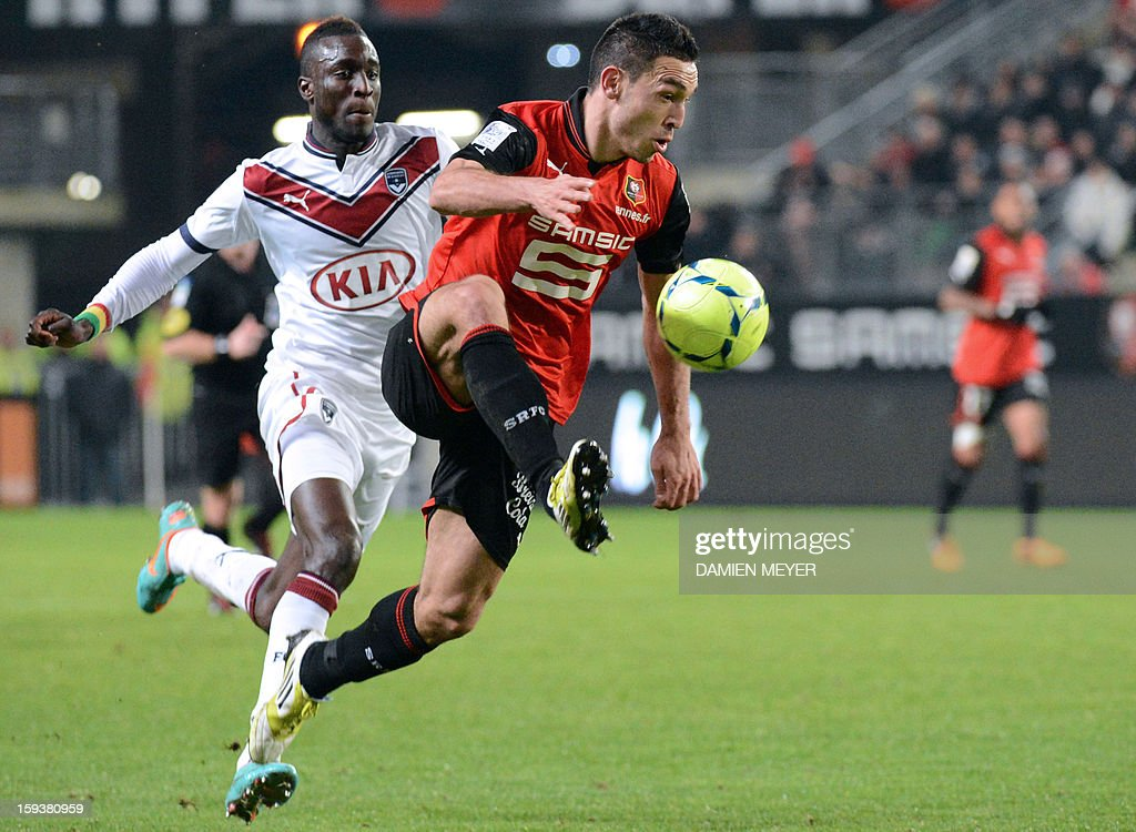 Rennes' French forward Mevlut Erding (R) vies for the ball with Bordeaux's Senegalse defender Ludovic Sane during the French L1 football match between Rennes and Bordeaux on January 12, 2013, at the Route de Lorient stadium in Rennes, western France.