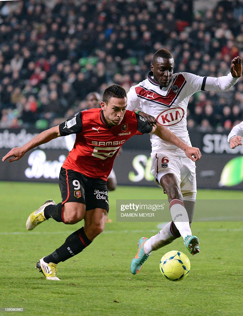 Rennes' French forward Mevlut Erding (R) vies for the ball with Bordeaux's Senegalse defender Ludovic Sane during the French L1 football match between Rennes and Bordeaux on January 12, 2013, at the Route de Lorient stadium in Rennes, western France. AFP PHOTO / DAMIEN MEYER