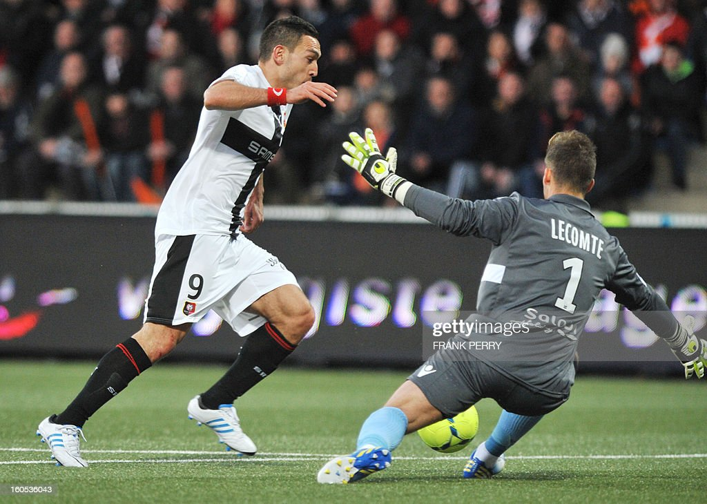 Rennes' French forward Mevlut Erding (L) vies with Lorient's French goalkeeper Benjamin Lecomte (R) during the French L1 football match Lorient vs Rennes on February 2, 2013 at the Moustoir Stadium in Lorient, western France.