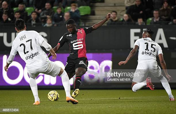 Rennes' French forward PaulGeorges Ntep prepares to kick the ball to score a goal past Metz's Argentine defender Jose Luis Palomino during the French...
