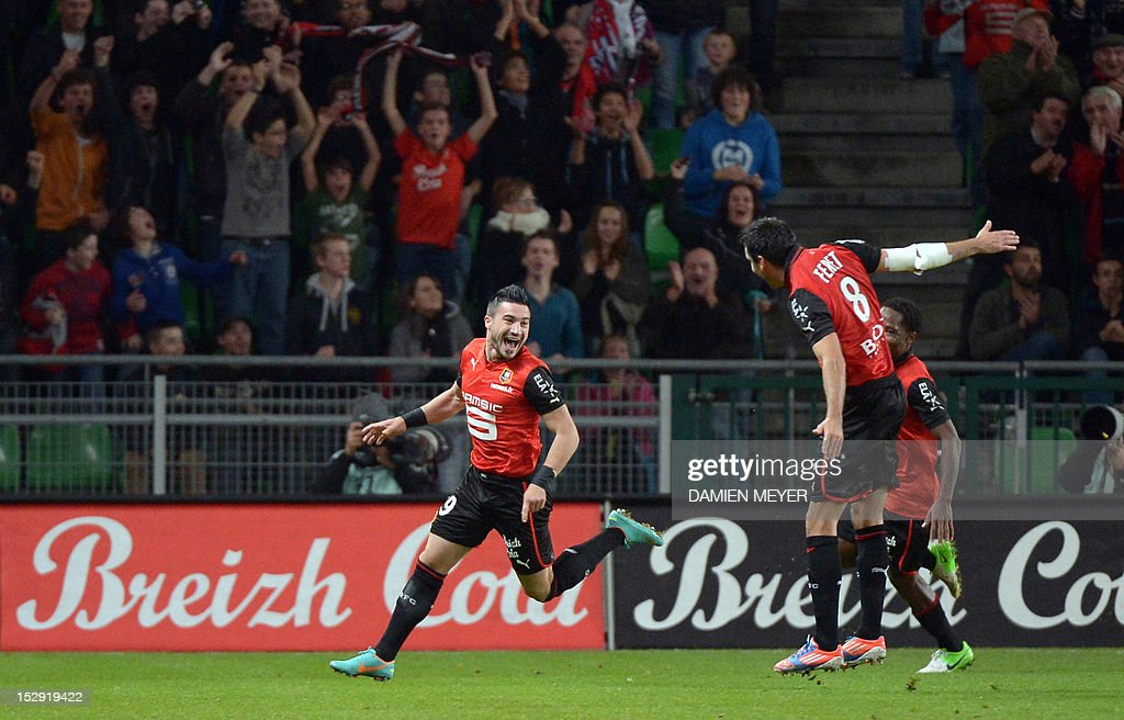 Rennes' French forward Romain Alessandrini (C) celebrates with Rennes' French midfielder Julien Feret after scoring during the French L1 football match Stade Rennais FC vs Lille LOSC, on September 28, 2012, at the route de Lorient stadium in Rennes, western France.