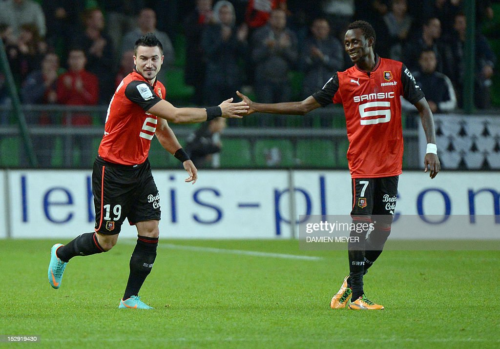 Rennes' French forward Romain Alessandrini (L) celebrates with Rennes' French forward Jonathan Pitroipa after scoring during the French L1 football match Stade Rennais FC vs Lille LOSC, on September 28, 2012, at the route de Lorient stadium in Rennes, western France.