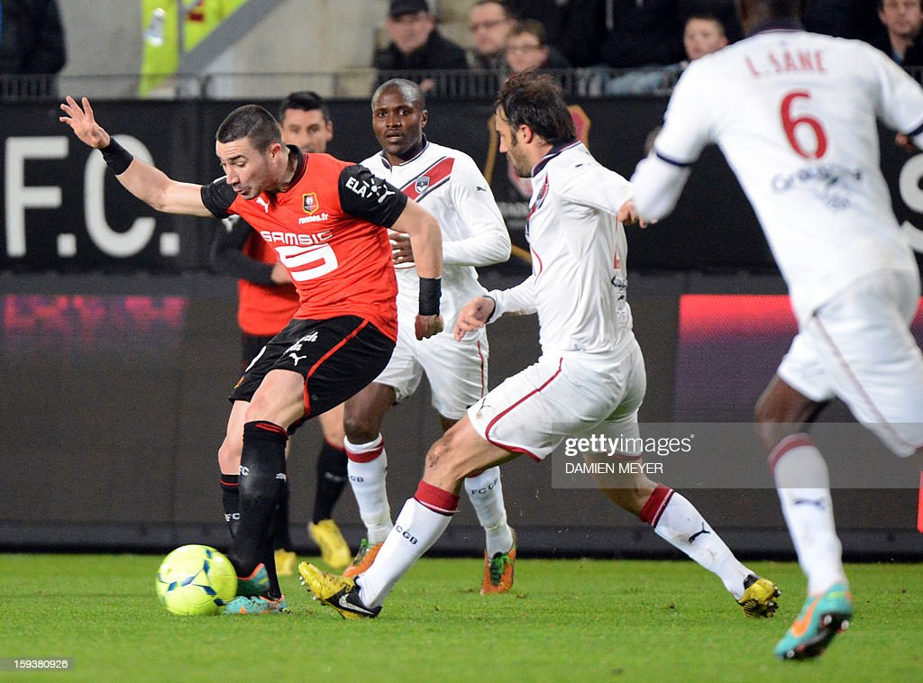 Rennes' French forward Romain Alessandrini (L) vies for the ball with Bordeaux's French defender Marc Planus during the French L1 football match between Rennes and Bordeaux on January 12, 2013, at the Route de Lorient stadium in Rennes, western France.