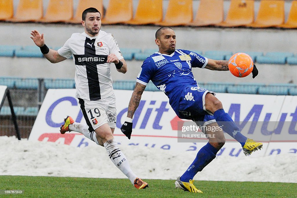Rennes' French forward Romain Alessandrini (R) vies for the ball with Bastia's French defender Gael Angoula during the French L1 football match between Bastia and Rennes, on January 20, 2013, at the Jean Laville stadium in Gueugnon.
