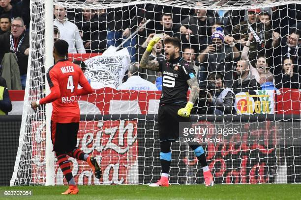 Rennes' French goalkeeper Benoit Costil reacts after saving a penalty kick during the French L1 football match between Rennes and Lyon on April 2 at...