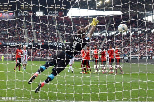 Rennes' French goalkeeper Benoit Costil saves a goal during the French L1 football match between Rennes and Lyon on April 2 2017 at the Roazhon park...