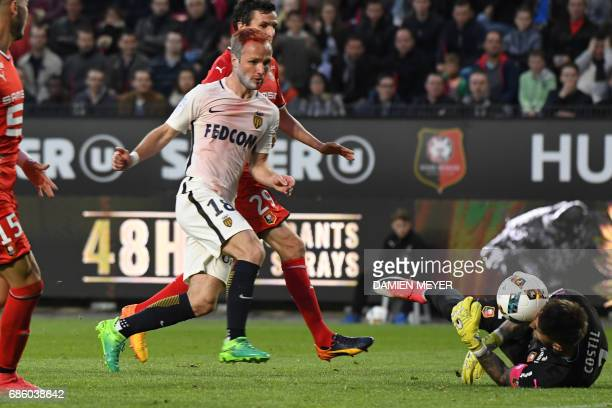 Rennes' French goalkeeper Benoit Costil saves a goal from Monaco's French forward Valere Germain during the French L1 football match between Rennes...