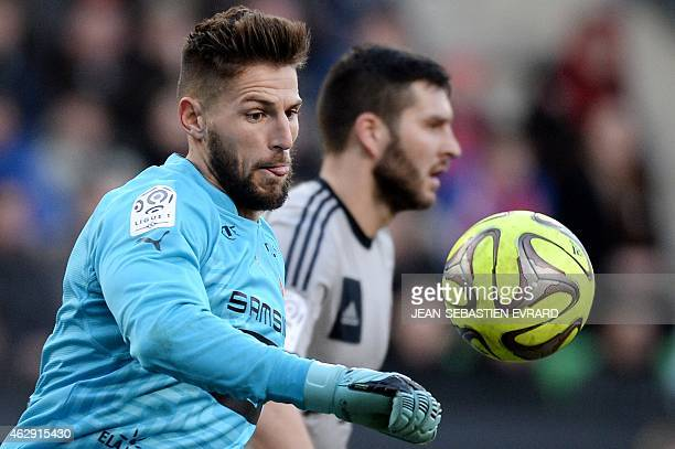 Rennes' French goalkeeper Benoit Costil throws the ball during the French L1 football match between Rennes and Marseille on February 7 2015 at the...