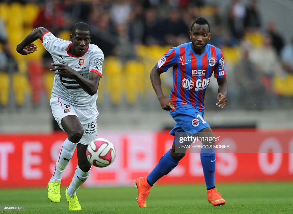 Rennes' French midfielder Abdoulaye Doucoure vies for the ball with Caen's French forward Lenny Nangis during the French L1 football match between...