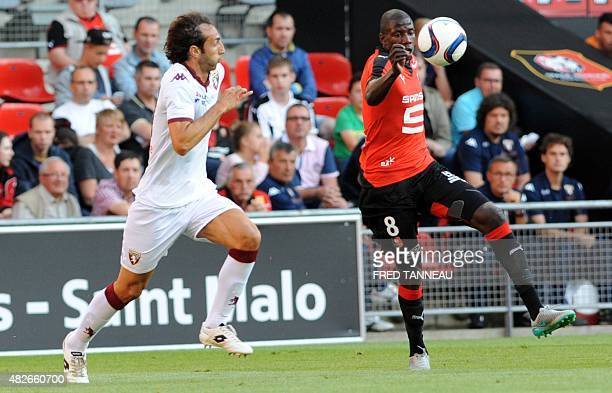 Rennes' French midfielder Abdoulaye Doucoure vies for the ball with Torino's Italian defender Emiliano Moretti during the friendly football match...