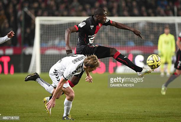 Rennes' French midfielder Abdoulaye Doucoure vies with Reims' French defender Franck Signorino during the French L1 football match Rennes vs Reims on...