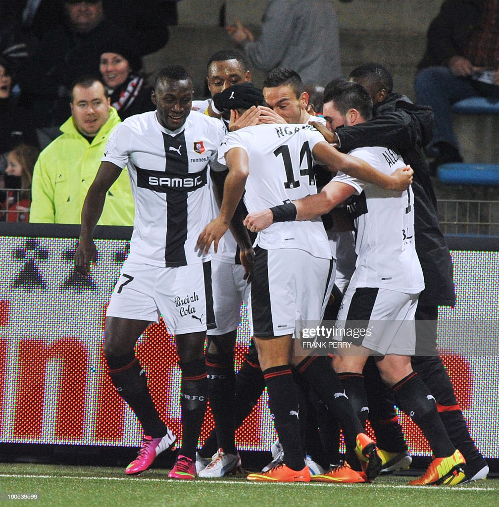 Rennes' French midfielder Axel Ngando (C) jubilates with teammates after scoring a goal during the French L1 football match Lorient vs Rennes on February 2, 2013 at the Moustoir Stadium in Lorient, western France.