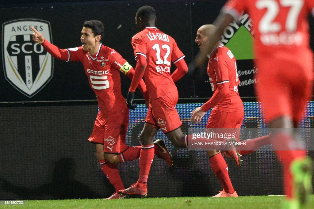 Rennes' French midfielder Benjamin Andre (L) celebrates after scoring during the French L1 Football match between Angers (SCO) and Rennes (Stade Rennais FC), on November 29, 2017, in Raymond-Kopa Stadium, in Angers, northwestern France. MONIER