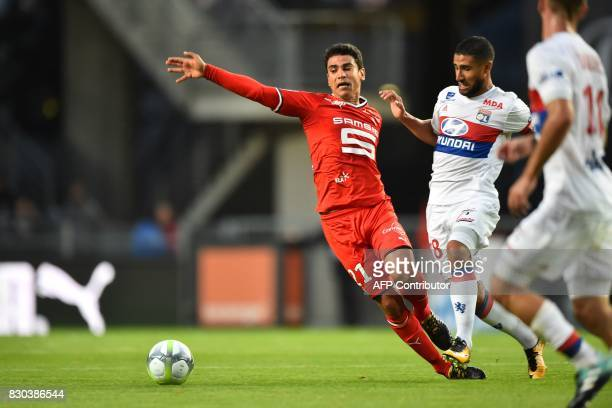 Rennes' French midfielder Benjamin Andre vies for the ball with Lyon's French midfielder Nabil Fekir during the French L1 football match between...
