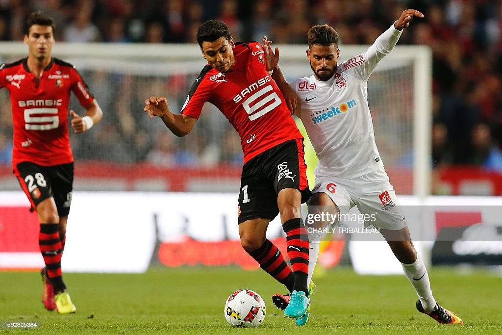 Rennes' French midfielder Benjamin Andre vies for the ball with Nancy's French midfielder Youssef Aït Bennasser during the French L1 football match...
