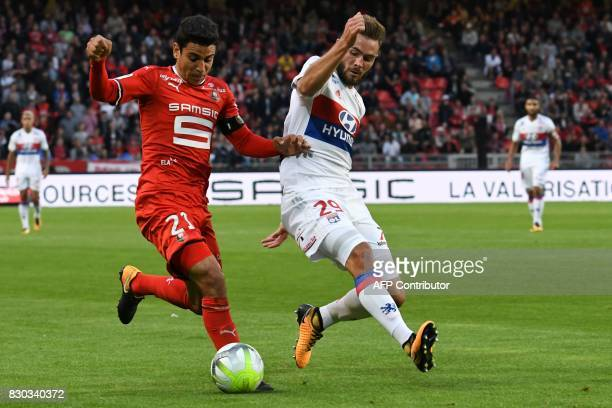 Rennes' French midfielder Benjamin Andre vies for the ball withLyon's French midfielder Lucas Tousart during the French L1 football match between...