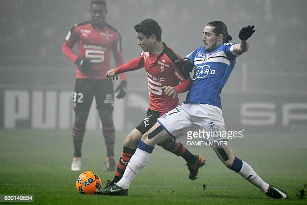 Rennes' French midfielder Benjamin Andre vies with Bastia's French forward Enzo Crivelli during the French L1 football match Rennes against Bastia on...