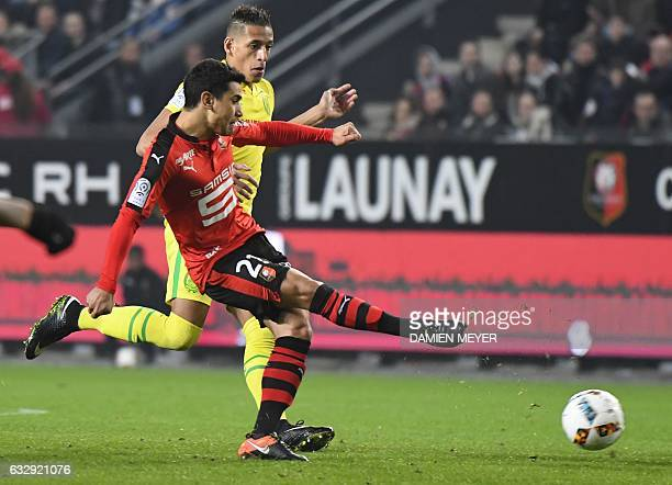 Rennes' French midfielder Benjamin Andre vies with Nantes' French forward Yacine Bammou during the French L1 football match between Rennes and Nantes...