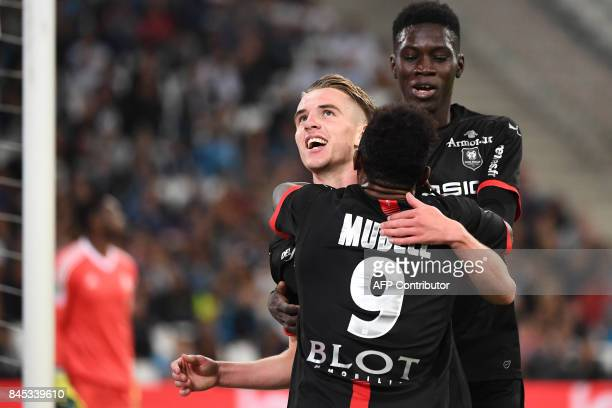 Rennes' French midfielder Benjamin Bourigeaud celebrates with teammates after scoring the second goal during the French L1 football match Olympique...