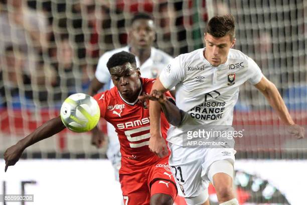 Rennes' French midfielder Faitout Maouassa fights for the ball against Caen's French defender Frederic Guilbert during the French L1 football match...