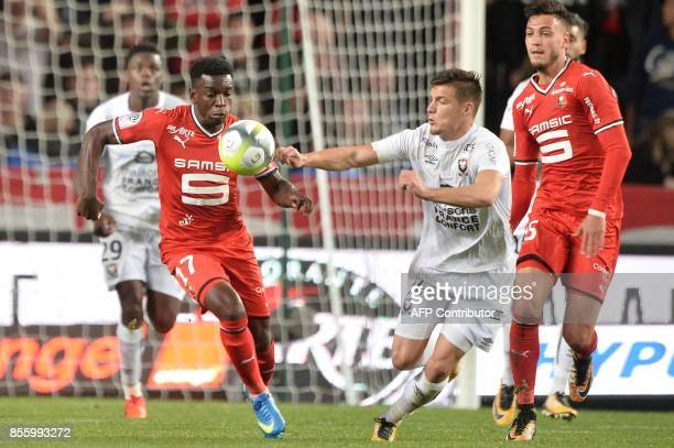 Rennes' French midfielder Faitout Maouassa vies with Caen's French defender Frederic Guilbert during the French L1 football match between Stade...