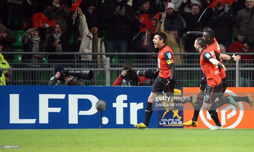 Rennes' French midfielder Julien Feret (L) celebrates after scoring a goal during the French League Cup semifinal football match Rennes against Montpellier on January 16, 2013 at the route de Lorient stadium in Rennes, western France.