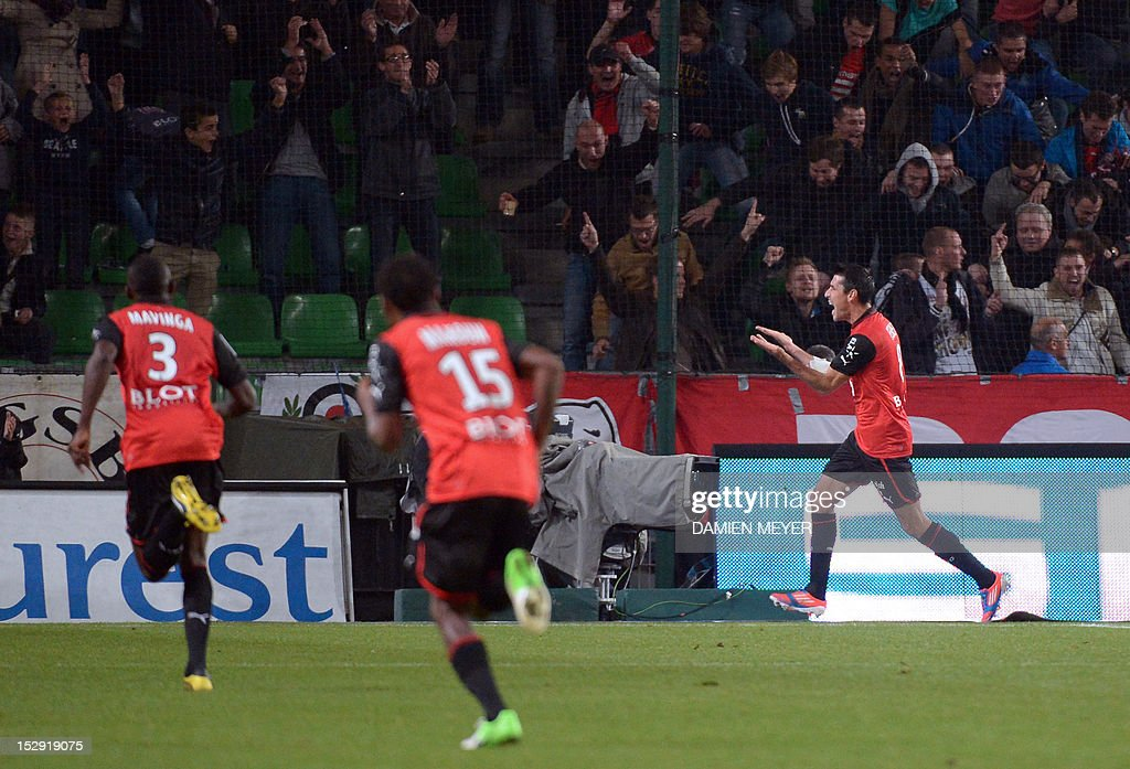 Rennes' French midfielder Julien Feret (R) celebrates with teammates after scoring during the French L1 football match Stade Rennais FC vs Lille LOSC, on September 28, 2012, at the route de Lorient stadium in Rennes, western France.