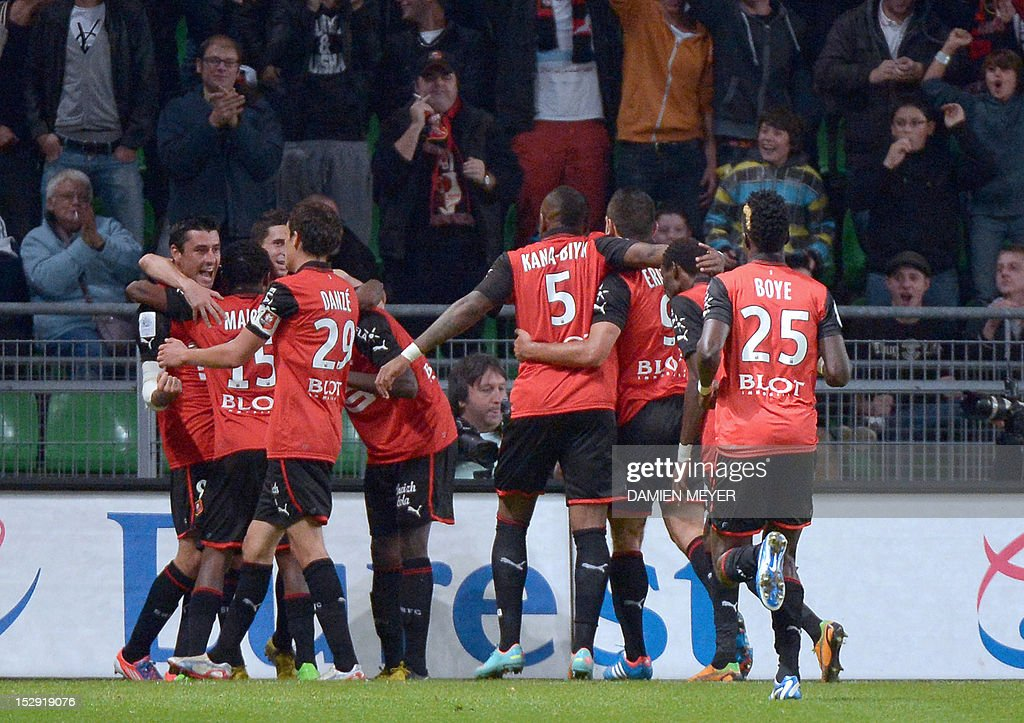 Rennes' French midfielder Julien Feret (L) celebrates with teammates after scoring during the French L1 football match Stade Rennais FC vs Lille LOSC, on September 28, 2012, at the route de Lorient stadium in Rennes, western France.
