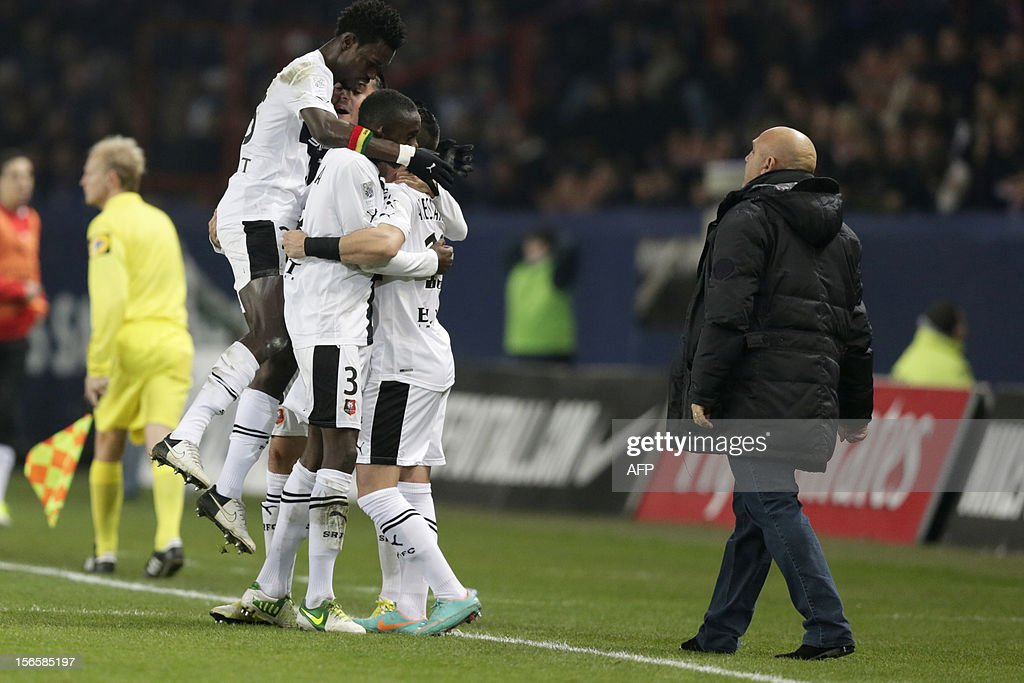 Rennes' French midfielder Julien Feret celebrates with teammates after scoring a goal during the French Ligue 1 football match Paris Saint-Germain (PSG) vs Rennes (SRFC) on November 17, 2012 at the Parc des Princes stadium, in Paris.