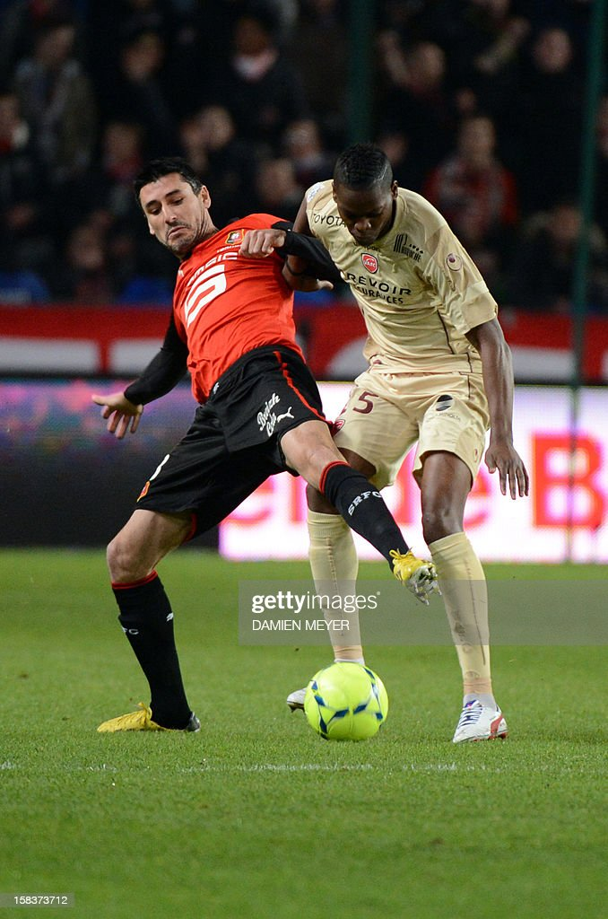 Rennes' French midfielder Julien Feret (L) fights for the ball with Valenciennes' French defender Nicolas Isimat-Mirin during the French L1 football match Rennes against Valenciennes on December 14, 2012 at the route de Lorient stadium in Rennes, western France.