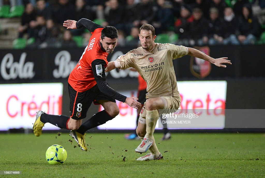 Rennes' French midfielder Julien Feret (L) fights for the ball with Valenciennes' French forward Gregory Pujol during the French L1 football match Rennes against Valenciennes on December 14, 2012 at the route de Lorient stadium in Rennes, western France.