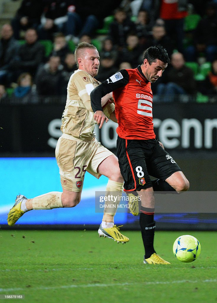 Rennes' French midfielder Julien Feret (R) fights for the ball with Valenciennes' French defender Rudy Mater during the French L1 football match Rennes (SRFC) vs Valenciennes FC on December 14, 2012 at the route de Lorient stadium in Rennes, western France.