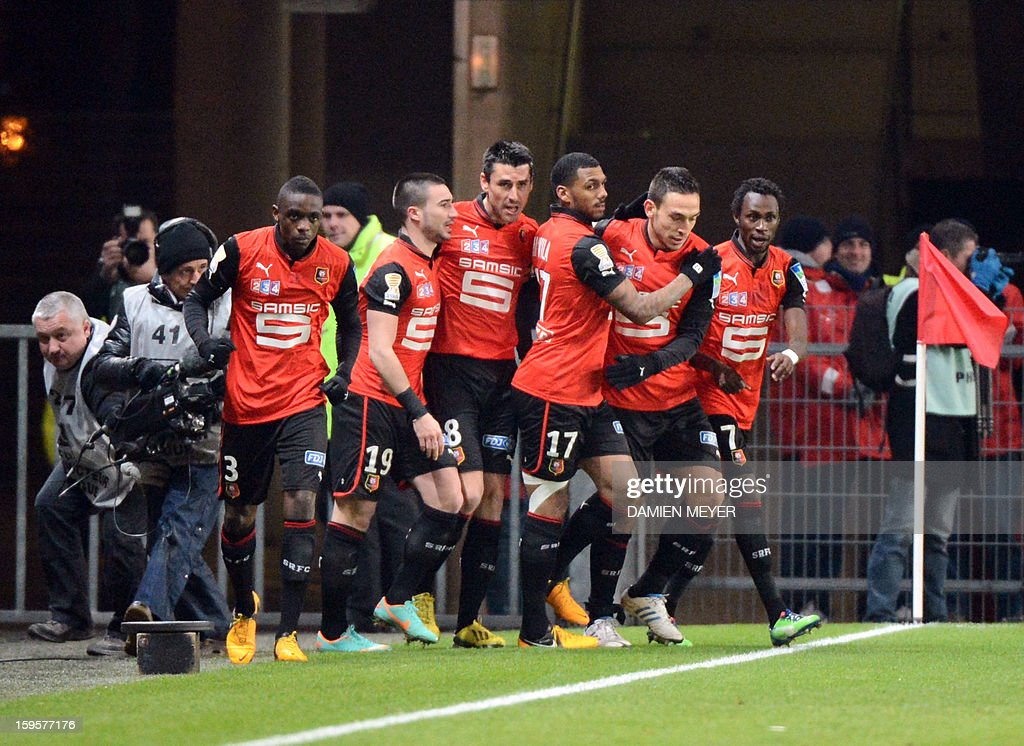 Rennes' French midfielder Julien Feret (C) is congratulated by teammates after scoring a goal during the French League Cup semifinal football match Rennes against Montpellier on January 16, 2013 at the route de Lorient stadium in Rennes, western France.