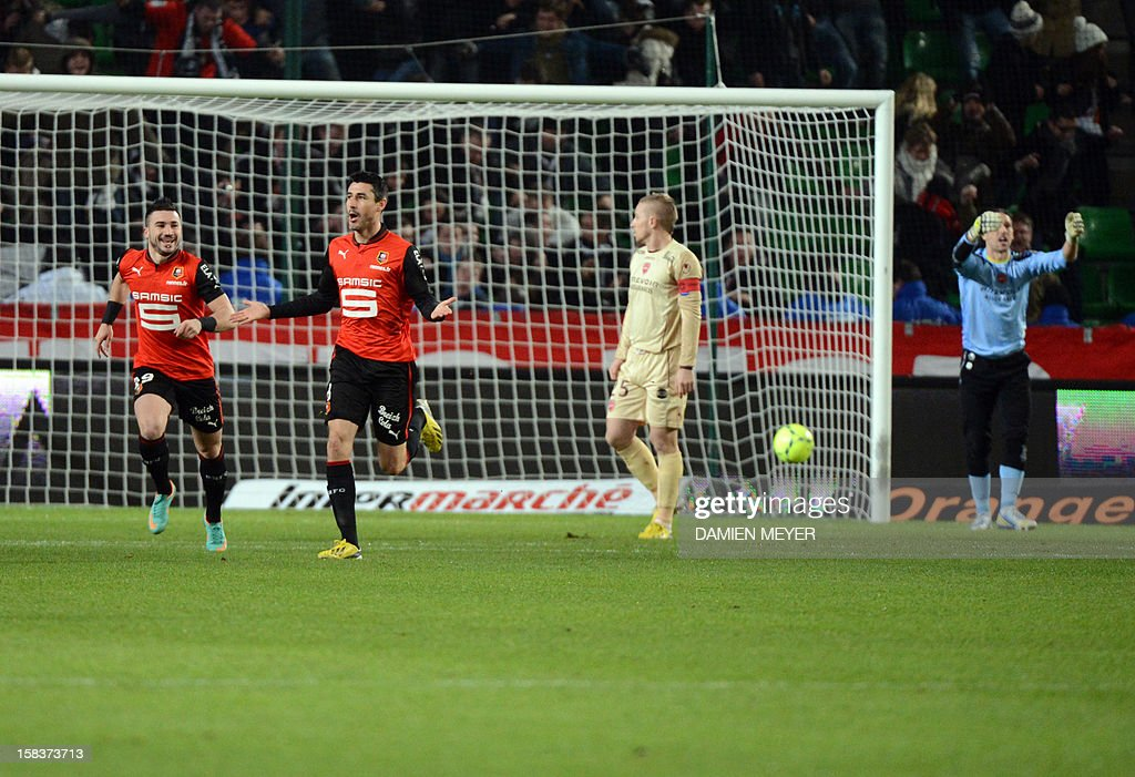 Rennes' French midfielder Julien Feret (2L) jubilates next to Rennes' French forward Romain Alessandrini (L) after scoring during the French L1 football match Rennes against Valenciennes on December 14, 2012 at the route de Lorient stadium in Rennes, western France.