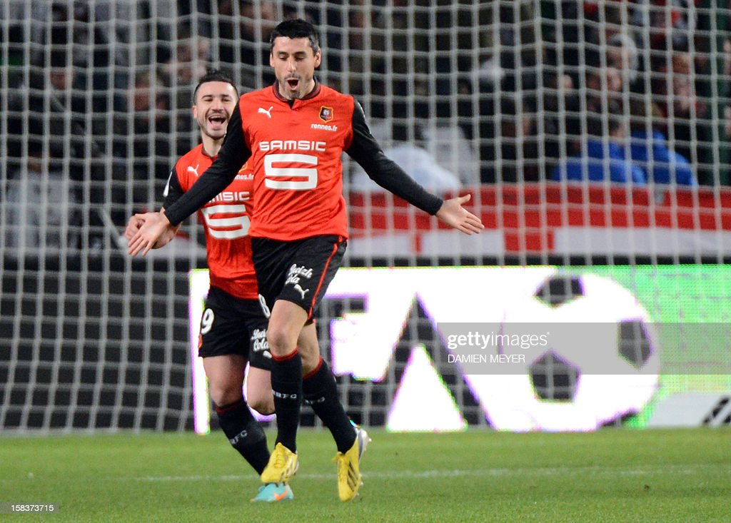 Rennes' French midfielder Julien Feret (R) jubilates next to Rennes' French forward Romain Alessandrini (L) after scoring during the French L1 football match Rennes against Valenciennes on December 14, 2012 at the route de Lorient stadium in Rennes, western France.