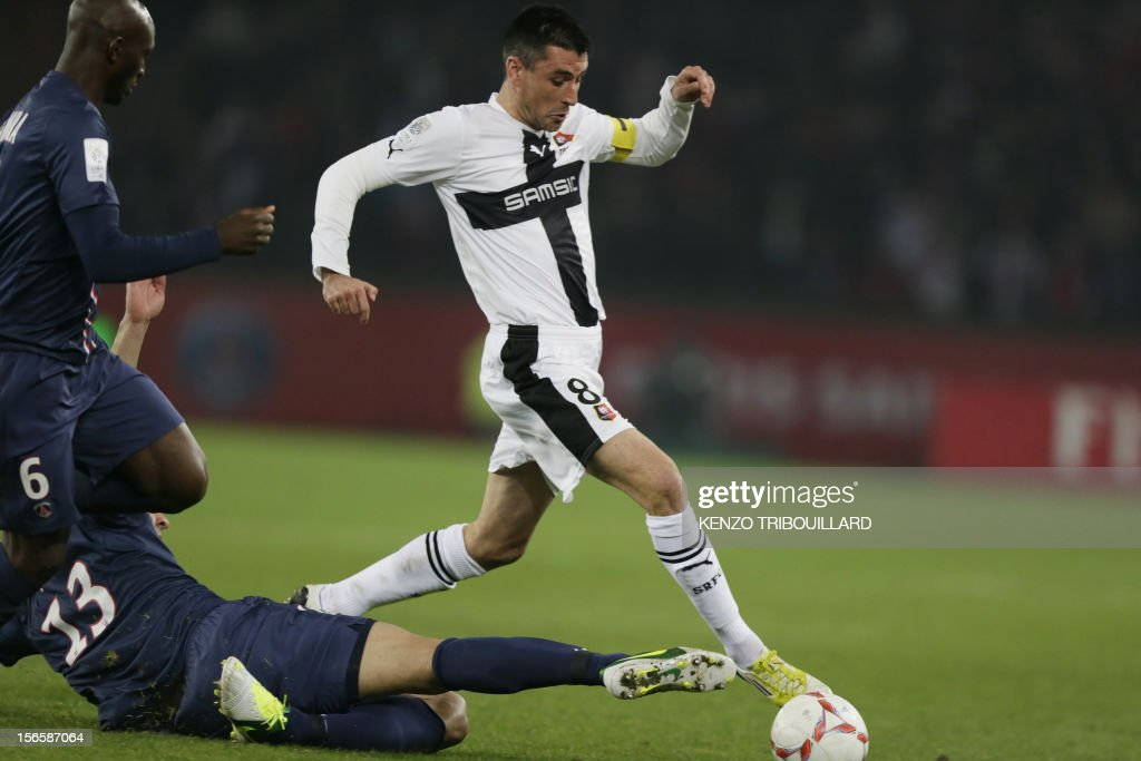 Rennes' French midfielder Julien Feret (C) kicks the ball away from PSG players during the French Ligue 1 football match between Paris Saint-Germain (PSG) and Rennes (SRFC) on November 17, 2012, at the Parc des Princes stadium, in Paris.