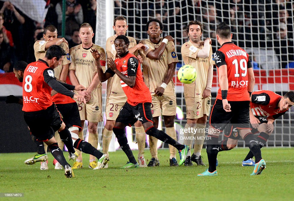Rennes' French midfielder Julien Feret (L) kicks the ball during the French L1 football match Rennes against Valenciennes on December 14, 2012 at the route de Lorient stadium in Rennes, western France.