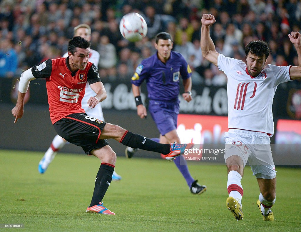 Rennes' French midfielder Julien Feret (L) kicks the ball next to Lille's Montenegrin defender Marko Basa during the French L1 football match Stade Rennais FC vs Lille LOSC, on September 28, 2012, at the route de Lorient stadium in Rennes, western France.
