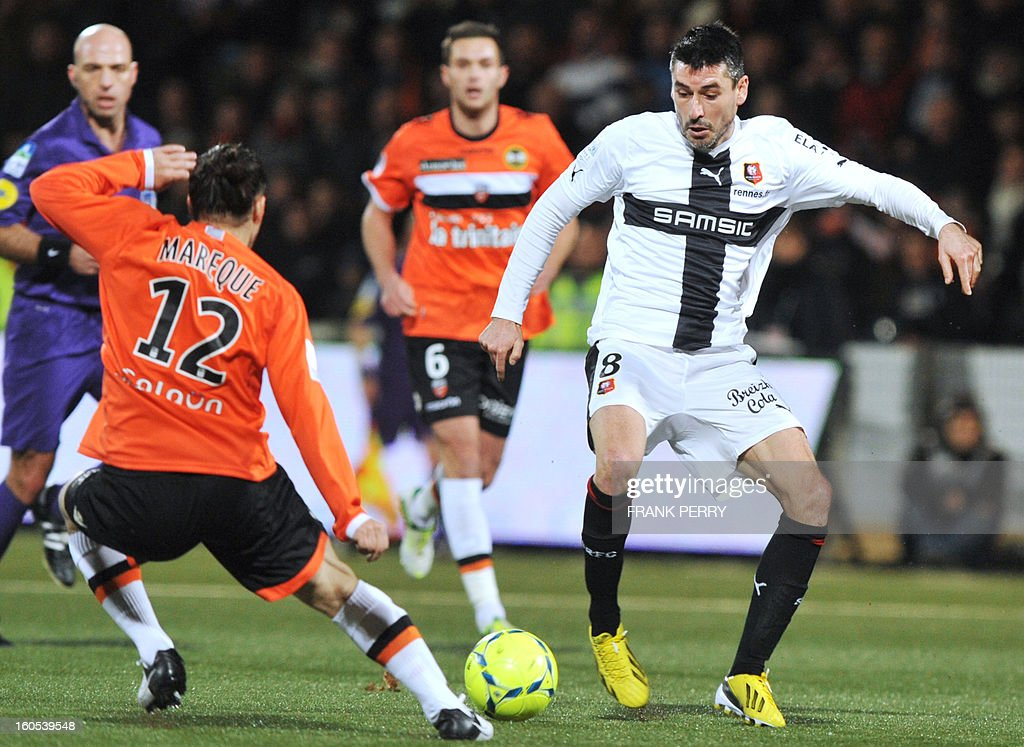 Rennes' French midfielder Julien Feret (C) vies with Lorient's Argentinian defender Lucas Mareque Buccolini (L) during a French L1 football match between Lorient and Rennes on February 2, 2013 at the Moustoir Stadium in Lorient, western France.