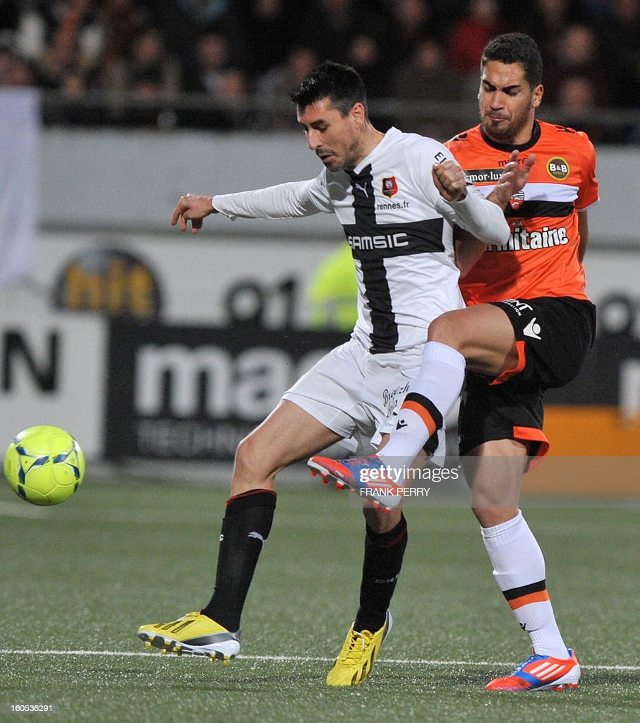 Rennes' French midfielder Julien Feret (L) vies with Lorient's French defender Wesley Lautoa (R) during a French L1 football match between Lorient and Rennes on February 2, 2013 at the Moustoir Stadium in Lorient, western France.