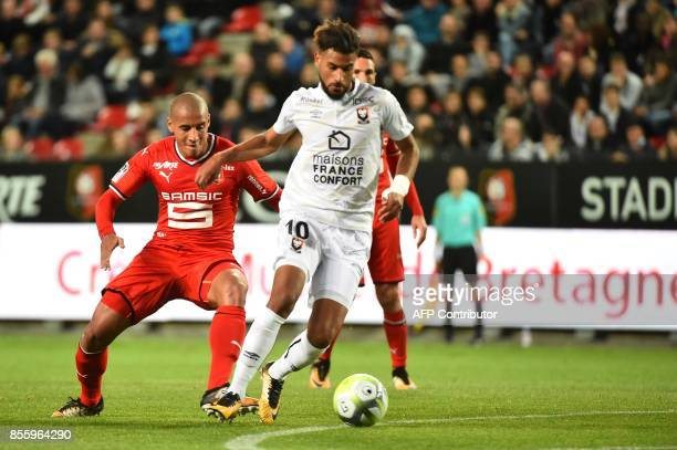 Rennes' French midfielder Morgan Amalfitano vies with Caen's FrenchMoroccan midfielder Youssef Ait Bennasser during the French L1 football match...