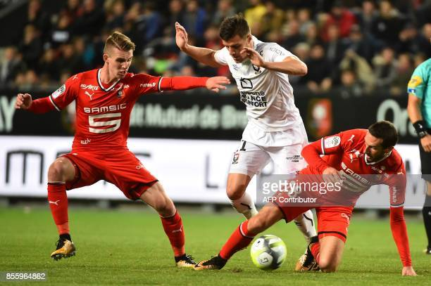Rennes' French midfielder Morgan Amalfitano vies with Caen's FrenchMoroccan midfielder Youssef Ait Bennasser and Rennes' French midfielder Benjamin...