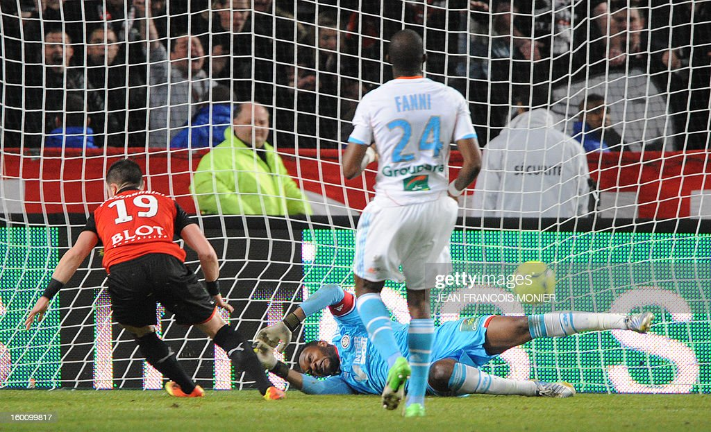 Rennes' French midfielder Romain Alessandrini (L) scores past Marseille's Steve Mandanda (R) Stade Rennais during their French L1 football match Stade Rennais FC versus Marseille, on January 26, 2013 at the Route de Lorient Stadium in Rennes, western France.